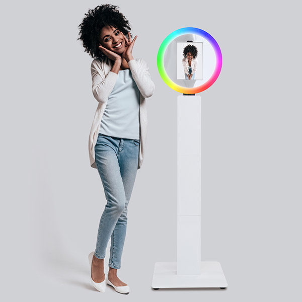 young lady posing with mobibooth cruise plus photo kiosk and cruise roamer